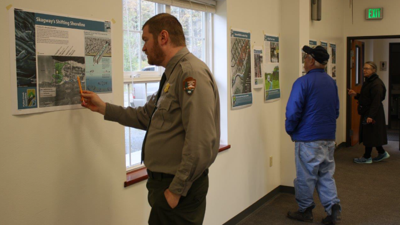 A National Park Service Employee takes a look at one of the interpretive signs, September 30, 2015