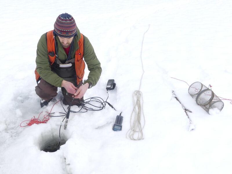 ADF&G Habitat Biologist Greg Albrecht measures water chemistry in the east dredge pond in Fish Creek Estuary. Photo courtesy of John Hudson.